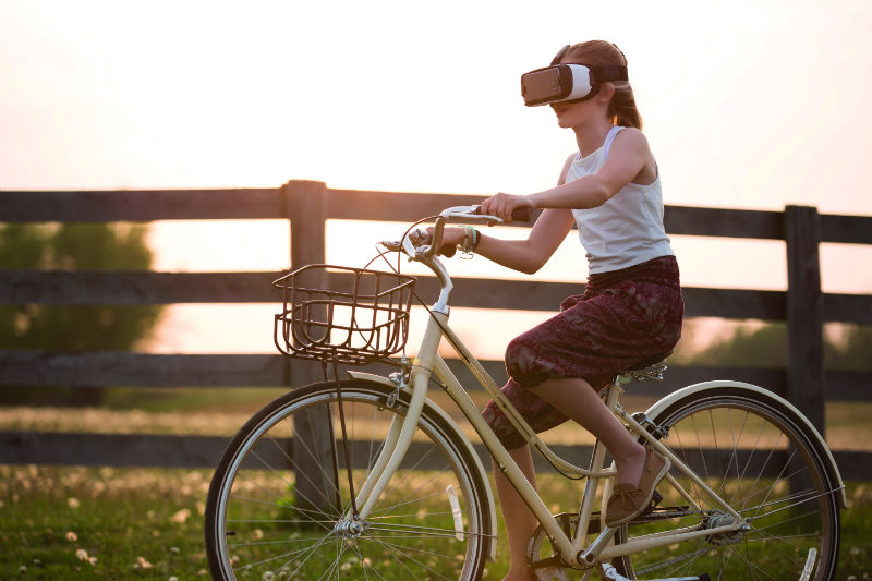 ar-headset-girl-on-bike-1518097779.jpg