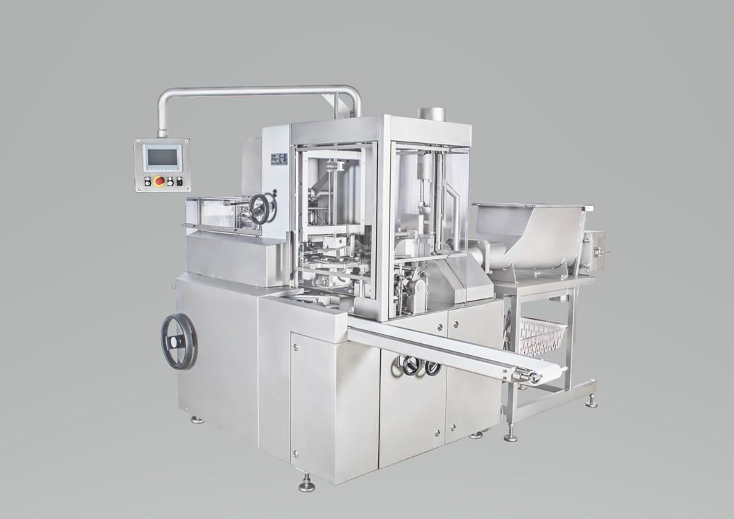 Автомат для дозирования и упаковки масла